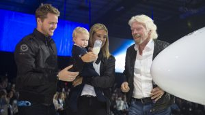 Branson's 1 year old granddaughter christens the ship, using milk in place of champagne