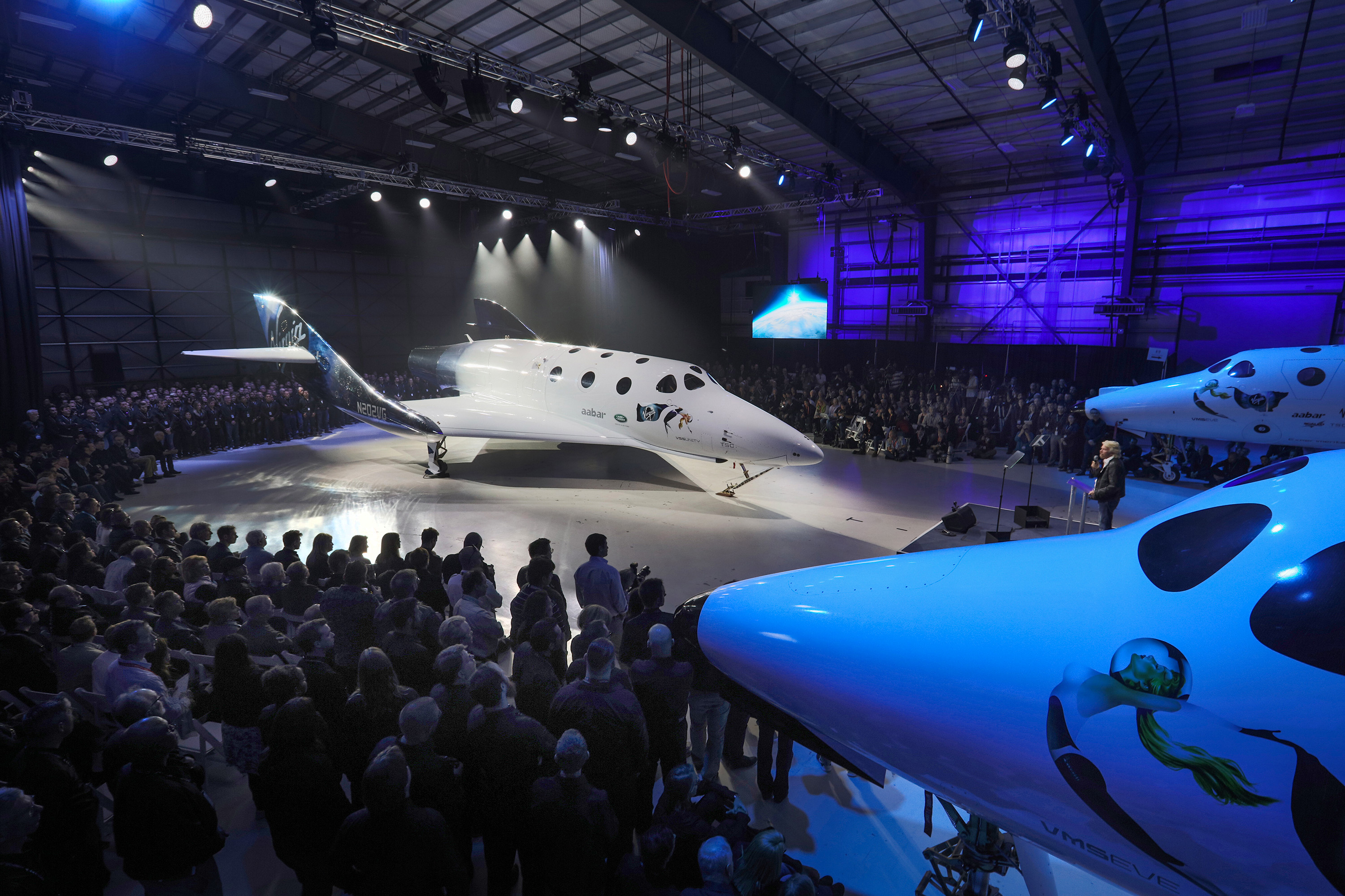 Virgin Spaceship Unity is unveiled in Mojave, California, Friday February 19th, 2016. VSS Unity is the first vehicle to be manufactured by The Spaceship Company, Virgin Galactic's wholly owned manufacturing arm, and is the second vehicle of its design ever constructed. VSS Unity was unveiled in FAITH (Final Assembly Integration Test Hangar), the Mojave-based home of manufacturing and testing for Virgin Galactic's human space flight program. VSS Unity featured a new silver and white livery and was guided into position by one of the company's support Range Rovers, provided by its exclusive automotive partner Land Rover...