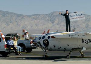 Paul Allen, Burt Rutan and Mike Melvill celebrate the flight of SpaceShipOne in Mojave, CA